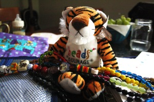 A collection of the beads that Lily received for her treatment including chemo, blood tests, days of isolation spent in hospitals and various procedures.